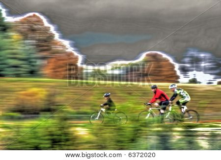 Family Bicycle Riders In Fall Colors And Motion Blur