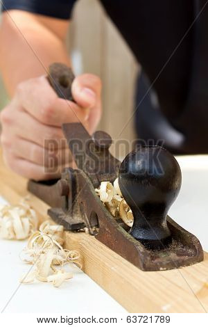 Hands Of A Carpenter With A Planer