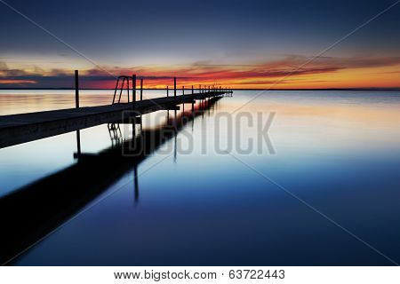 Landing Stage By The Sea At Sunset