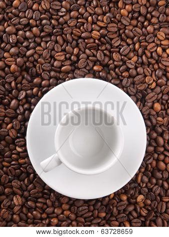 A white cup on beans background