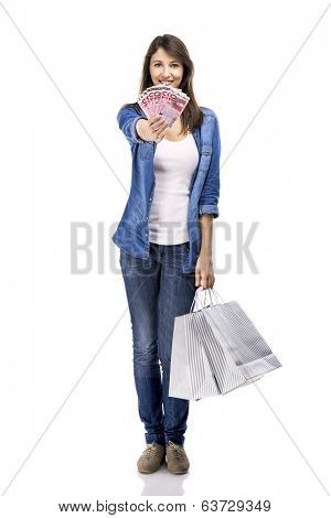 Beauitful woman holding shopping bags and some Euro currency notes, isolated over white background