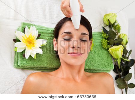 Woman Getting A Face Treatment