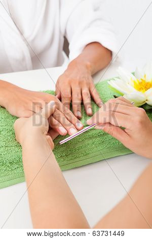 Beautician Polishing The Nails