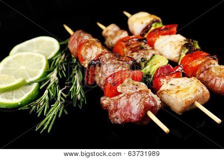 Pork kebab on black background