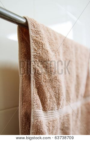 Brown Towel On A Hanger