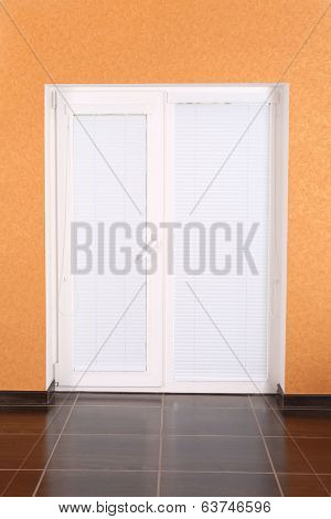 White plastic door with closed blinds