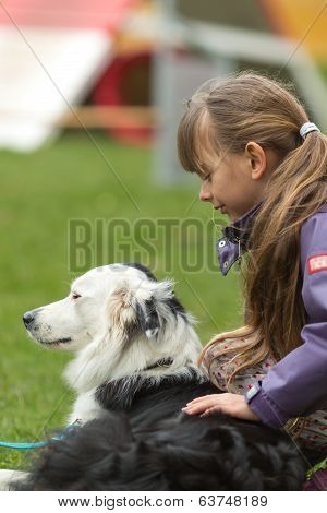 Girl Patting Dog
