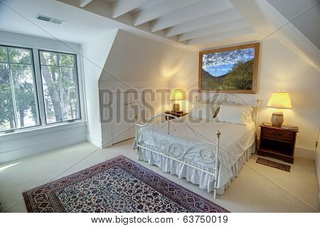 simple upstairs bedroom with double windows