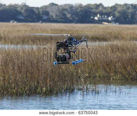 helicopter drone with camera flying over water