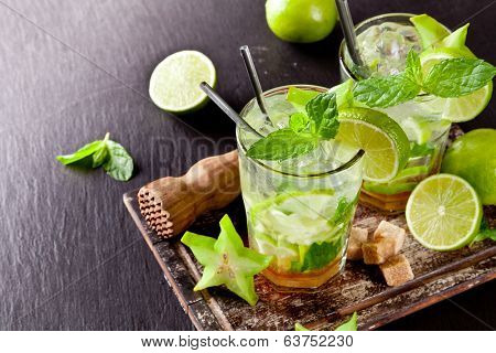 Mojito lime drinks on stone, shot from upper view