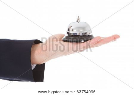 Person's Hand Holding Service Bell