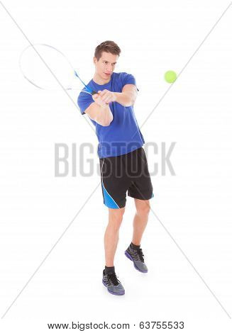 Portrait Of Young Man Playing With Tennis Racquet