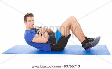 Young Man Doing Crunches