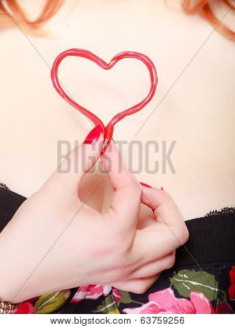 Female Hand Holding Valentine Red Heart Love. Valentines Day.