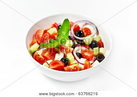 Light Greek Salad With Fresh Vegetables, Garnished With Basil. White Background.