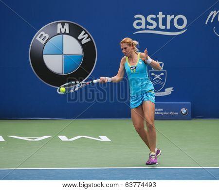 KUALA LUMPUR - APRIL 19, 2014:  Olga Savchuk returns in the semifinals of the BMW Malaysian Open in Kuala Lumpur, Malaysia. Partnering Lyudmyla Kichenok, they lost to Chan YungJan and Zheng Saisai.