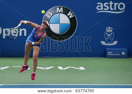 KUALA LUMPUR - APRIL 19, 2014: Zheng Saisai serves in the semifinals of the BMW Malaysian Open tennis in Kuala Lumpur, Malaysia. Partnering Chan YungJan, they beat Olga Savchuk and Lyudmyla Kichenok.