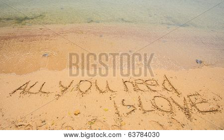 All you need is love written in the sand