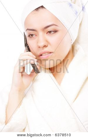 Woman In Bathrobe Talking On Phone
