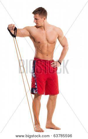 Bodybuilding. Attractive man with expander
