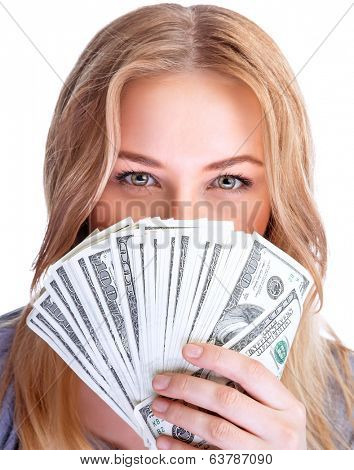Closeup portrait of young lady covers her face with a wad of american dollars, isolated on white background, business and finance concept
