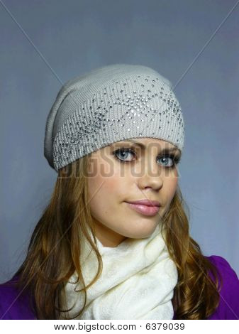 Blue-eyed Girl In A Grey Cap With Pastes