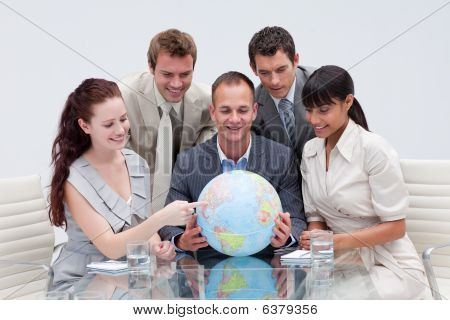 Business Team Holding A Terrestrial Globe. International Business