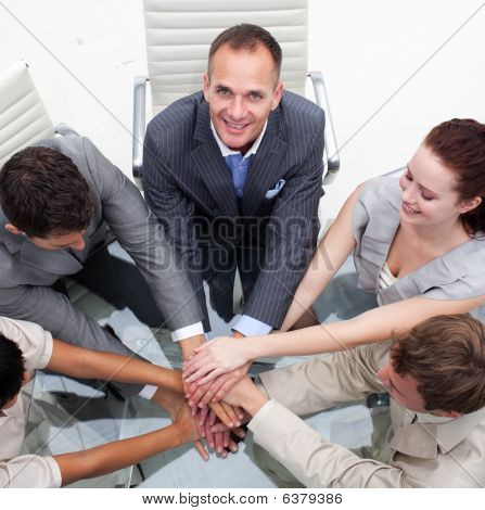 Close-up Of Multi-ethnic Business Team With Hands Together