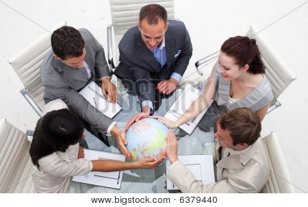 High Angle Of Business People Holding The World