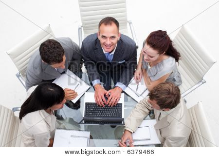 High Angle Of Business Manager Working With His Team