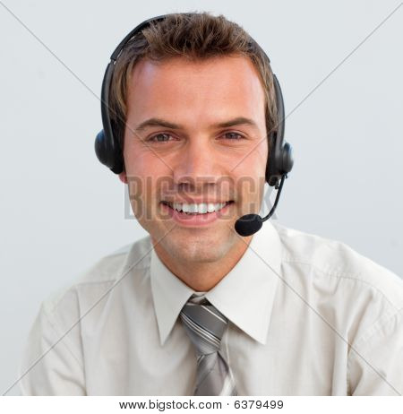 Portrait Of A Smiling Businessman With A Headset On