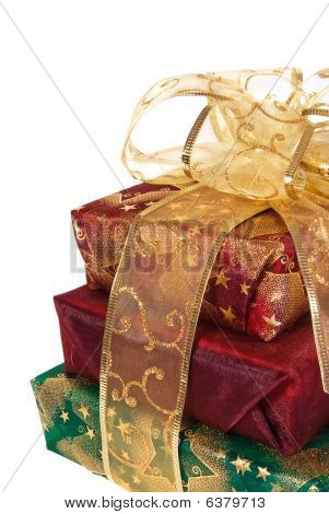 Three Wrapped Gift Boxes With Gold Ribbon And Bow - Vertical