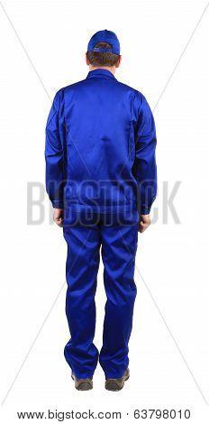 Worker in blue workwear. Back view.
