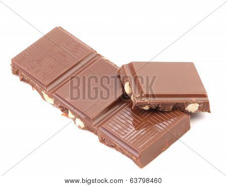 Tasty morsel of milk chocolate with nuts.