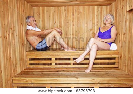 Senior couple relaxing together in a hotel sauna in their holidays
