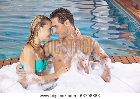 Couple in love in holiday spa resort relaxing in a whirlpool