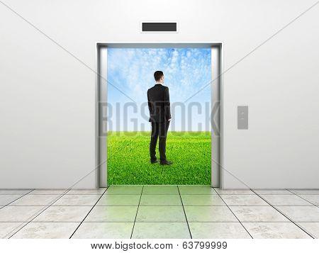 Businessman And Modern Elevator