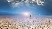 foto of nomads  - Wanderer on dried desert mud - JPG