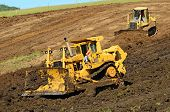 stock photo of dozer  - A large bulldozer grading a hillside in preperation for a major highway intersection project in Oregon - JPG