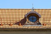 foto of gabled dormer window  - Gable dormers and red tiled roof of residential house - JPG