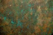 stock photo of copper  - Background image of scratched antique copper vessel surface texture - JPG