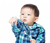 stock photo of spanking  - Baby child with funny hand gesture - JPG