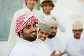 stock photo of oman  - Gulf Arabic Muslim people posing - JPG
