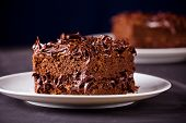 stock photo of chocolate fudge  - Close up of a tasty chocolate fudge with frosting for dessert - JPG