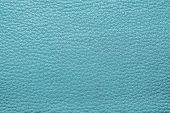 picture of pale skin  - abstract background from the painted texture of skin and leather fabric turquoise color - JPG