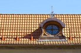 pic of gabled dormer window  - Gable dormers and red tiled roof of residential house - JPG