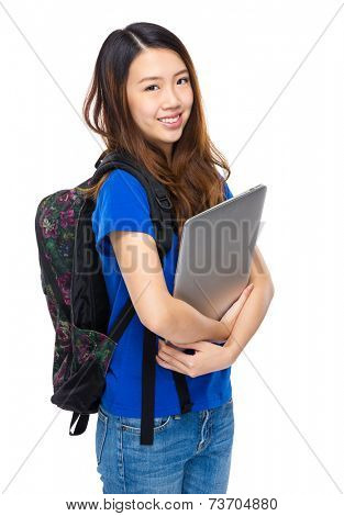 Young student with schoolbag and laptop computer