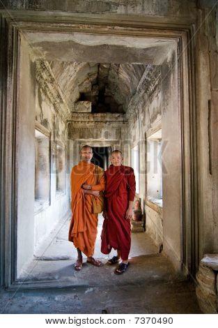 Two young Buddhist priests inside Angkor Wat