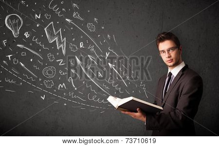 Young man reading a book while hand drawn sketches coming out of the book