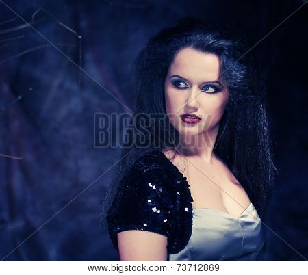 Photo of young beautiful lady with magnificent dark hair
